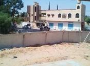 Libye Evacuation centaines migrants suite affrontements entre milices rivales Tripoli